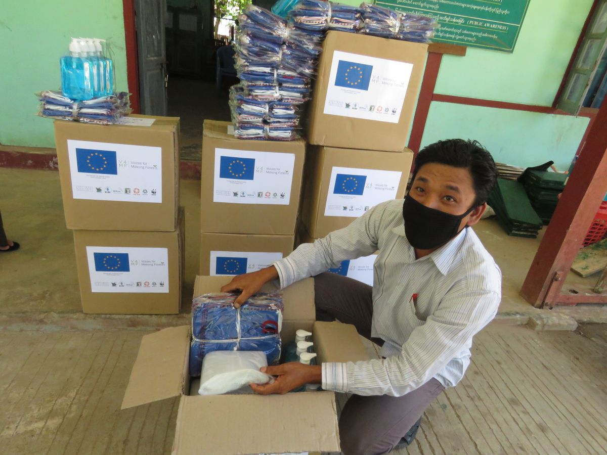 Man unboxes COVID-19 supplies from European Union