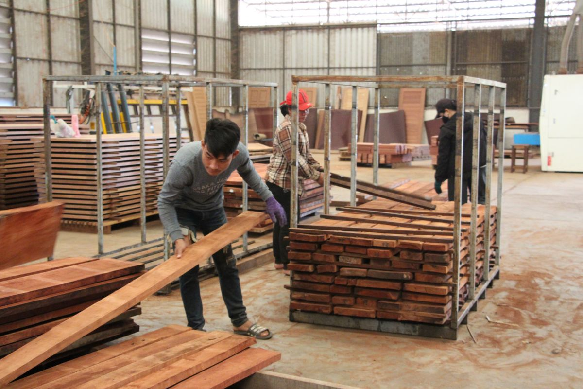 Man moves timber in Lao PDR factory