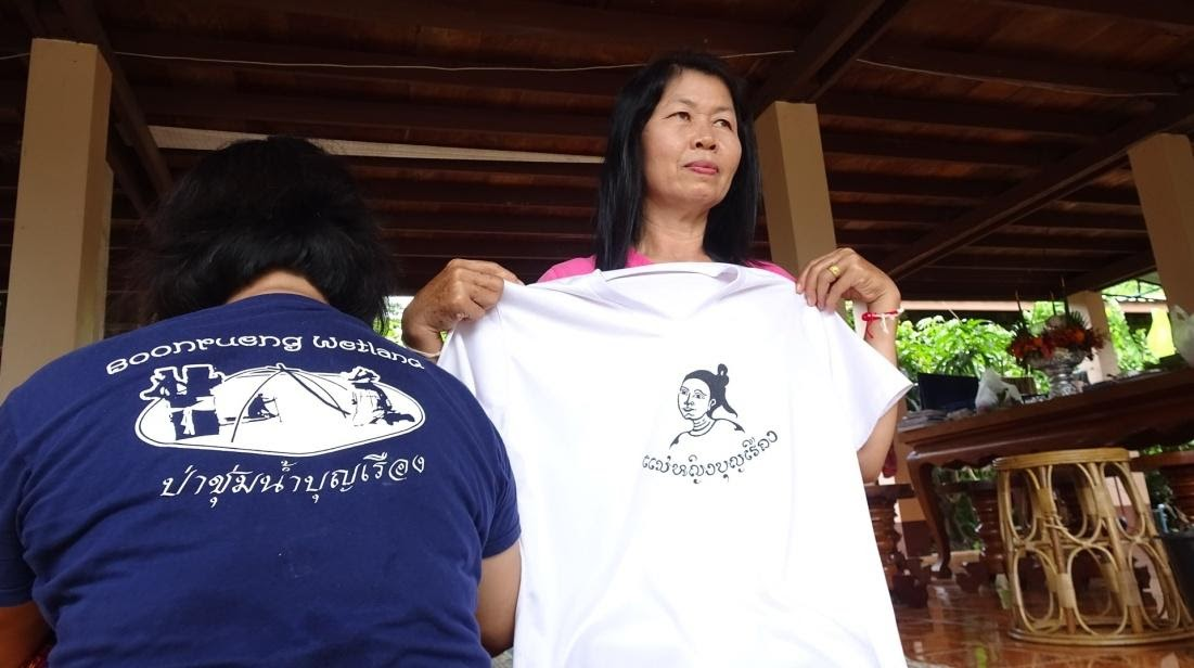 Boon Rueang woman holds up shirt